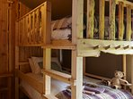 Adult sized bunk beds with ladder and low-level robe hooks. Safety rail if required.
