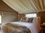 Over sized duvets, ceiling drapes, cushions and faux fur throw.  Cosy, comfy style.