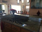 Gourmet kitchen with 5 burner cook top granite counter tops.