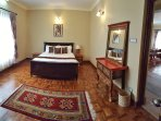 Designer Tibetan theme master bedroom with ensuite bathroom.