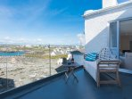 Enjoy the views from the balcony off the first floor living room