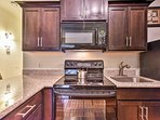 The fully equipped kitchen has updated appliances and ample counter space.