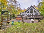 A serene mountain retreat awaits at this spacious vacation rental cabin in Pocono Lake.