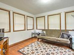 The futon in the sleeping porch provides additional sleeping and a flat-screen TV.