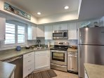 Relish the fully equipped kitchen's stainless steal appliances and ample counter space.