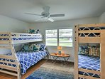 Kids will love falling asleep in this second bedroom, boasting 3 twin beds and a full bed.
