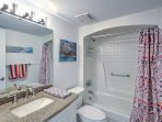 Freshen up after a day at the beach in this shower/tub combo.