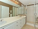 The Master Bath with Walk-in Shower and Dual Sinks