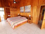 A king size bed and cedar finished walls and ceilings welcome you to Villa Serenidad.