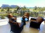Large Lanai overlooking the pool, with a dashing look of the Pacific blue