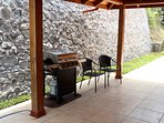 The BBQ grill sits under the carport. Rain or shine, the grill works great. Chicken is amazing in CR