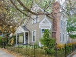Restored Victorian style home with a fully fenced yard.