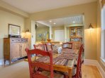 The dining area is open to the kitchen and living room. The table sits six and there are four more stools at the...