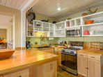 This fully equipped kitchen, with new appliances, has everything you need for a fabulous meals. There's a gourmet...