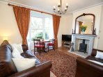 Ground floor lounge with dinning table in bay (seats 4) ideal for afternoon tea with a view.