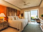 The Master suite has sweeping views of bay from the bed. Easy access to balcony. TV in room.