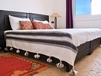 cosy double bed with ocean view