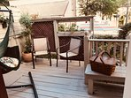 Veranda off kitchen- hammock swing and seating