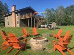 View of Le Chalet Montreuil from Fire Pit with 8 Adirondack Chairs