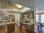 The fully equipped kitchen boasts granite countertops.