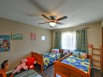 Perfect for the youngsters, this bedroom offers 2 twin beds.