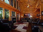 Plenty of room to gather around for family night or just to enjoy a movie in by the cozy fireplace.