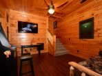 Downstairs you can enjoy some TV, or arcade games, Queen futon will sleep 2 additional guests.