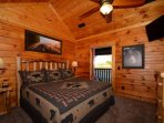 Upstairs you will find guest bedroom #1 with King-size bed, flatscreen TV, private bath with tub/shower combo and...