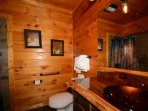 Upstairs private guest bathroom #1 features tub/shower combo