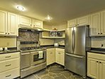 Whip up your famous recipe in the fully equipped kitchen with stainless steel appliances.