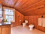 The third bathroom offers a walk-in shower and a large tub.