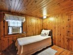 In the fifth bedroom, you'll find a twin-sized bed.