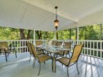 Why not eat outside on the upper balcony at the outdoor table with seating for 9?