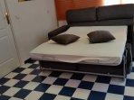 Sofa cama de apertura italiana.