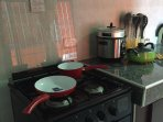 The kitchen is almost complete with oven, rice-cooker, toaster,...