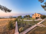 Garden and sea view in the sunset, front view of the house - Villa Russelia in Rhodes