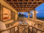 Dining table and armchairs in the veranda - Villa Russelia in Rhodes