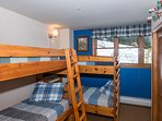 Third bedroom with two sets of twin bunks