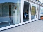 Step out of the large sliding door to the fantastic tiled terrace, ideal for those long summer days