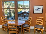 Look out at the slopes while you dine at this comfy table for four