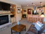 Cozy up with friends and family around the gas fireplace and large flat screen TV
