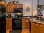 Beautifully remodeled kitchen with spacious granite counter tops