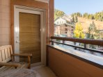Enjoy your morning coffee and mountain views on the private balcony