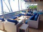 Oceanfront upper lanai seating and relaxing area.