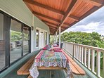 The spacious deck offers dining space, as well as lovely views.