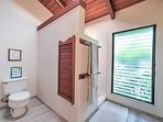 The master bathroom offers a spacious walk-in shower.