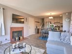 Relax in front of the gas fireplace and watch shows on the flat-screen cable TV.