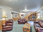 Downstairs, the family room has plenty of space to spread out and relax.