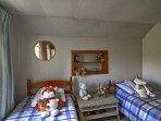Sibling or close friends can share this room with 2 twin beds.