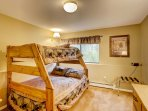 Siblings and friends will love this third bedroom with a twin-over-full bunk bed.